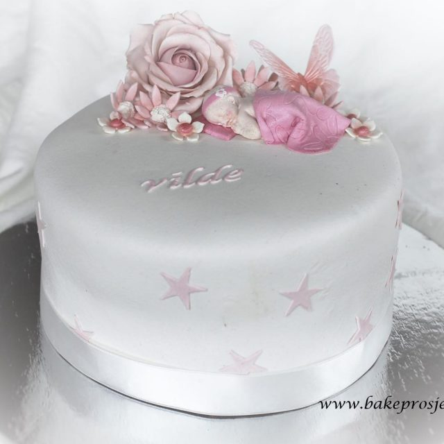 A christening cake I made this summer for a lovelyhellip